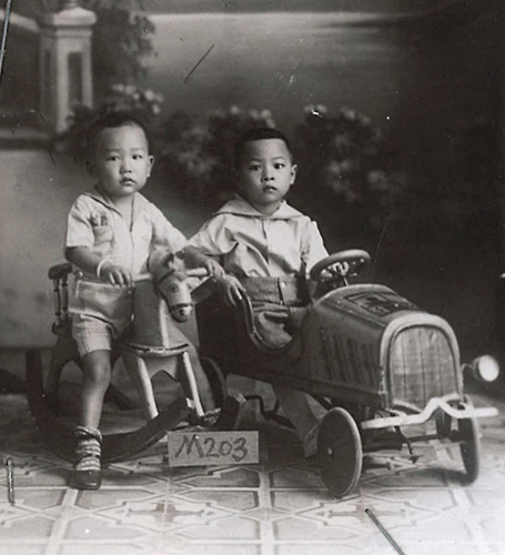 Lee Hong Tun and Lee Goon Ok with toy horse and toy truck